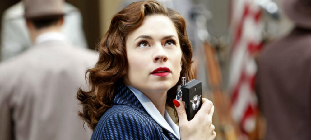 Agent Carter with a walkie talkie